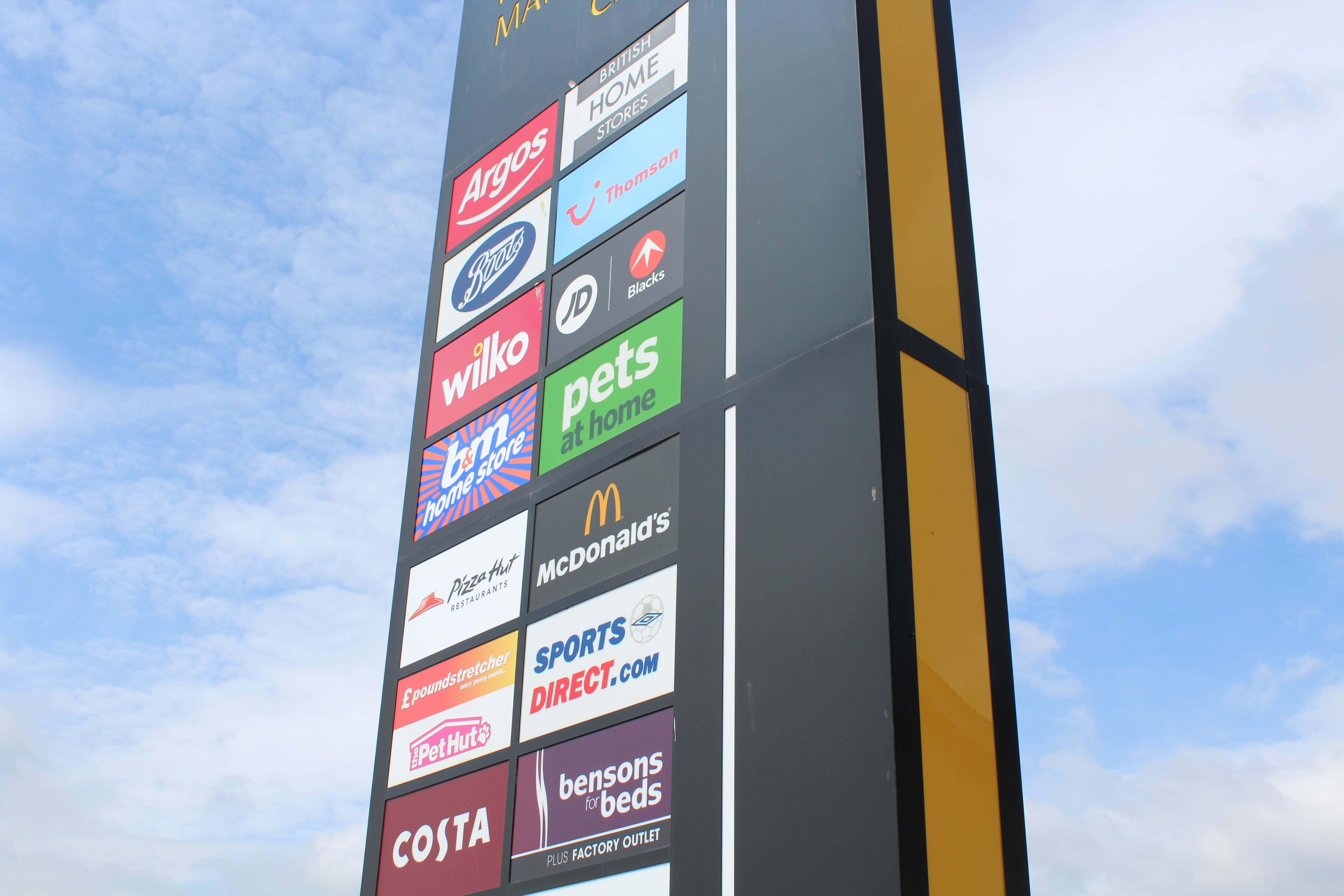Spray existing signage & fascias